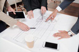 Team of Business People Discussing Construction Plans